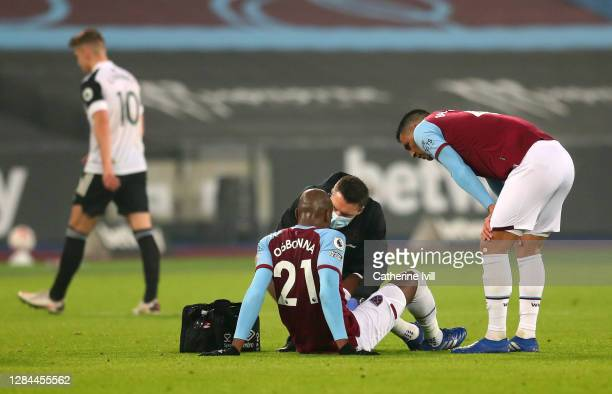 Angelo Ogbonna of West Ham United receives treatment during the Premier League match between West Ham United and Fulham at London Stadium on November...