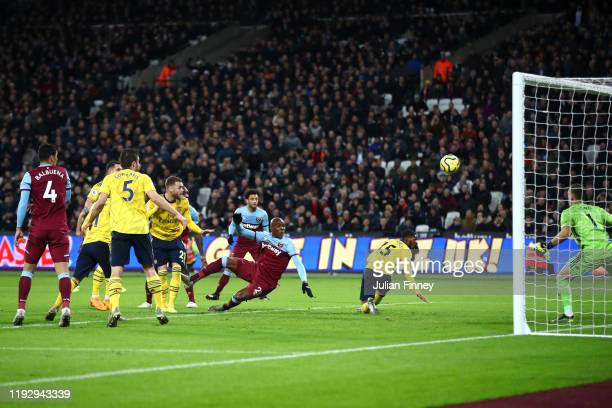 Angelo Ogbonna of West Ham United scores his sides first goal during the Premier League match between West Ham United and Arsenal FC at London...