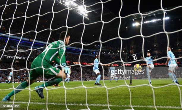 Angelo Ogbonna of West Ham United scores his sides first goal past Ederson of Manchester City during the Premier League match between Manchester City...