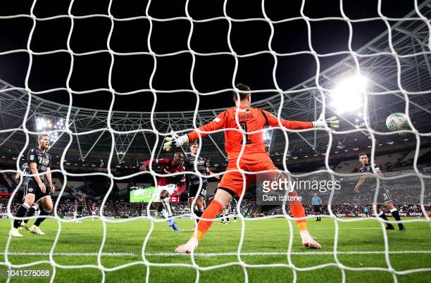 Angelo Ogbonna of West Ham United scores his team's fifth goal past Kieran O'Hara of Macclesfield Town during the Carabao Cup Third Round match...