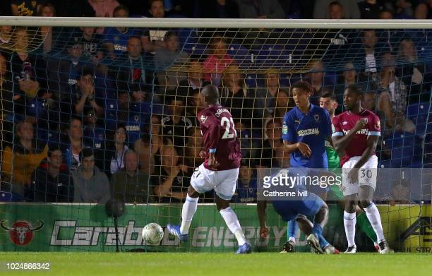 Angelo Ogbonna of West Ham United scores his team's second goal during the Carabao Cup Second Round match between AFC Wimbledon and West Ham United...