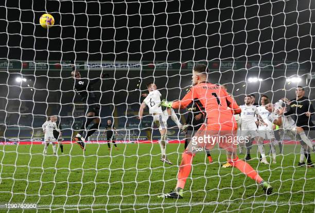 Angelo Ogbonna of West Ham United scores their sides second goal past Illan Meslier of Leeds United whilst under pressure from Liam Cooper of Leeds...
