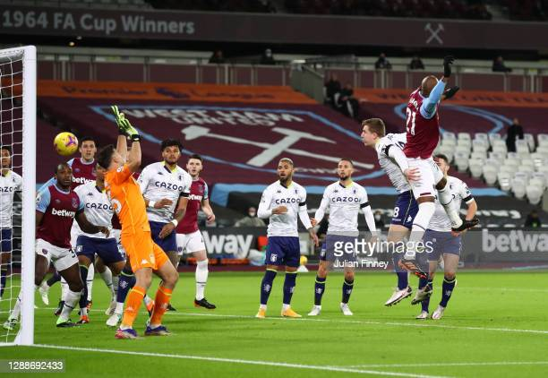 Angelo Ogbonna of West Ham United scores their team's first goal during the Premier League match between West Ham United and Aston Villa at London...