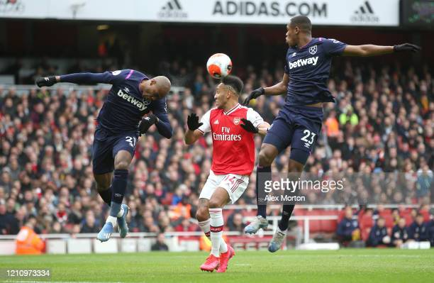 Angelo Ogbonna of West Ham United wins a header over PierreEmerick Aubameyang of Arsenal during the Premier League match between Arsenal FC and West...