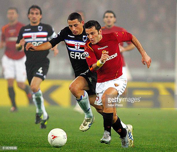 Angelo Palombo of Sampdoria attempts to control the ball from Vincenzo Montella of Roma during the Serie A Roma v Sampdoria match on December 5 2004...