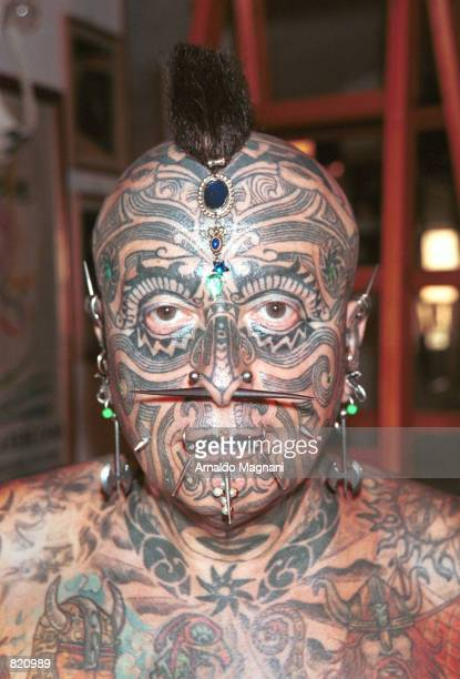 Angelo Piovano the world's most tattooed man poses for the photographer April 1 2001 in Torino Italy Piovano claims he was born a homosexual and as a...