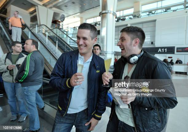USA Angelo Prato left and Stephen Kling join other passengers as they drink champaign and eat pink cupcakes at San Francisco International Airport...
