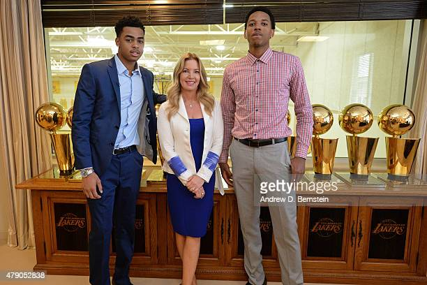 Angelo Russell and Anthony Brown of the Los Angeles Lakers pose for a photo with Jeanie Buss partowner and president before they attend a press...