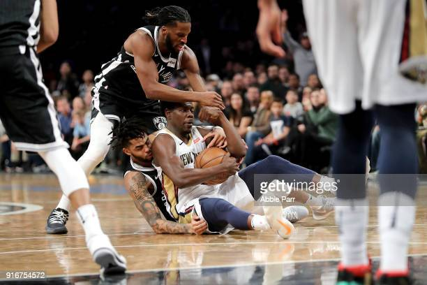 Angelo Russell and DeMarre Carroll of the Brooklyn Nets fight for the ball against Jrue Holiday of the New Orleans Pelicans in the fourth quarter...