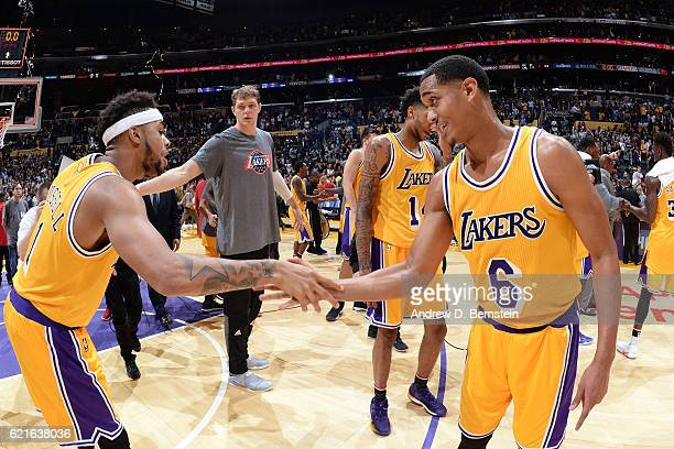 Angelo Russell and Jordan Clarkson of the Los Angeles Lakers shake hands during warm ups before the game against the Golden State Warriors on...