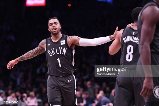 Angelo Russell and Spencer Dinwiddie of the Brooklyn Nets react during the game against the Dallas Mavericks at Barclays Center on March 04 2019 in...