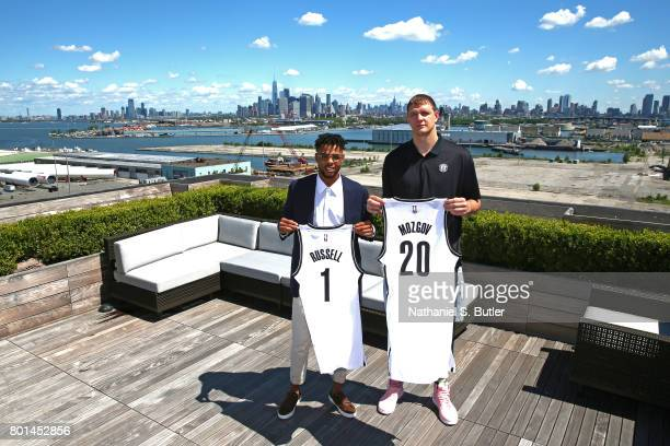 Angelo Russell and Timofey Mozgov of the Brooklyn Nets pose for a portrait after being introduced by the team on June 26 2017 at HSS Training Center...