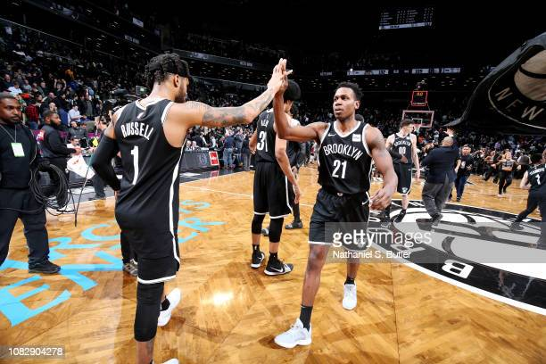 Angelo Russell and Treveon Graham of the Brooklyn Nets high five after the game against the Boston Celtics on January 14 2019 at Barclays Center in...