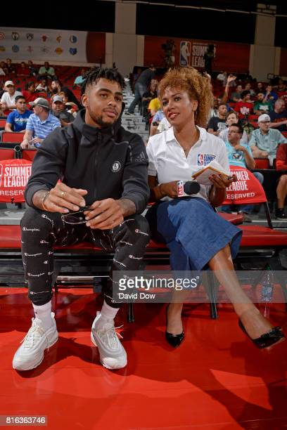 D' Angelo Russell of the Brooklyn Nets and NBA TV analyst Rosalyn GoldOnwude watch from the sidelines in a game against the Atlanta Hawks during the...