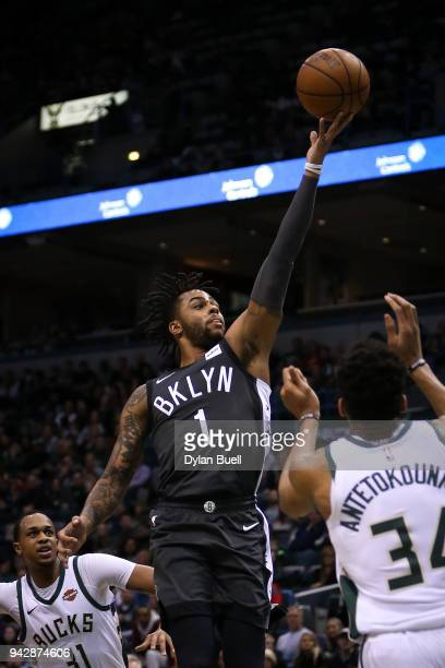 Angelo Russell of the Brooklyn Nets attempts a shot past Giannis Antetokounmpo of the Milwaukee Bucks in the first quarter at the Bradley Center on...