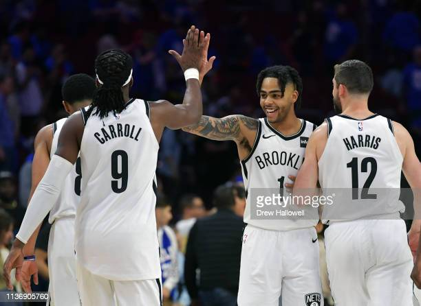 Angelo Russell of the Brooklyn Nets celebrates with teammates DeMarre Carroll and Joe Harris after beating the Philadelphia 76ers 111102 during Game...
