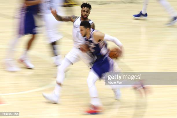 Angelo Russell of the Brooklyn Nets defends against Ben Simmons of the Philadelphia 76ers in the second half during their Pre Season game at Nassau...
