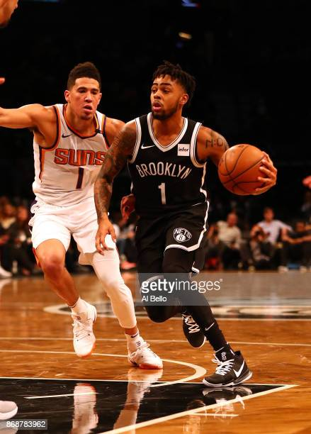 Angelo Russell of the Brooklyn Nets dribbles against Devin Booker of the Phoenix Suns during their game at Barclays Center on October 31 2017 in the...