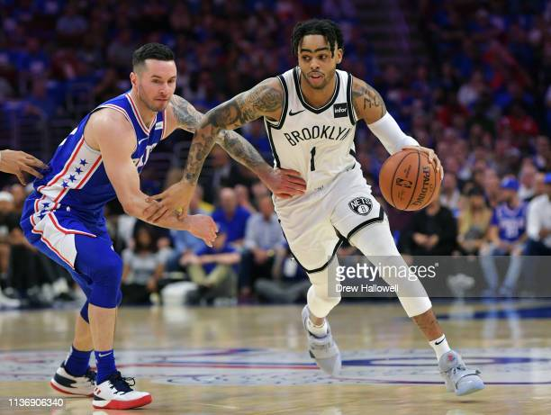 Angelo Russell of the Brooklyn Nets drives around JJ Redick of the Philadelphia 76ers in the first half during Game One of the first round of the...