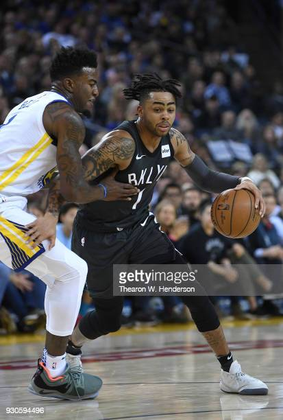 Angelo Russell of the Brooklyn Nets drives on Jordan Bell of the Golden State Warriors during an NBA basketball game at ORACLE Arena on March 6 2018...