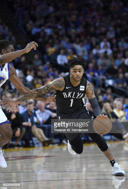 Angelo Russell of the Brooklyn Nets drives on Kevon Looney of the Golden State Warriors during an NBA basketball game at ORACLE Arena on March 6 2018...