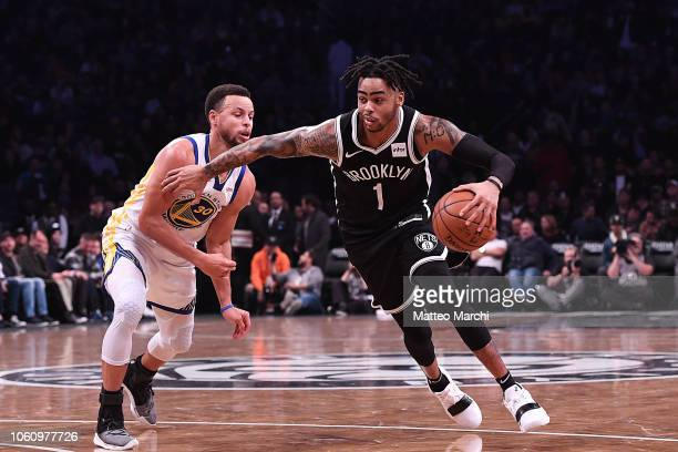Angelo Russell of the Brooklyn Nets drives to the basket against Stephen Curry of the Golden State Warriors during the game at Barclays Center on...