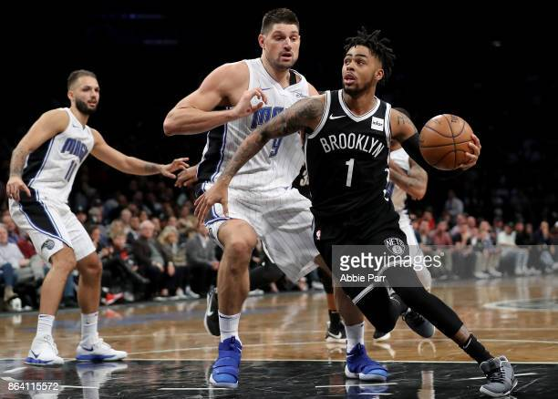 Angelo Russell of the Brooklyn Nets drives to the basket against Nikola Vucevic of the Orlando Magic in the second half during their game at Barclays...
