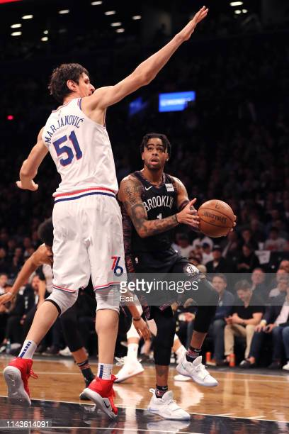 Angelo Russell of the Brooklyn Nets handles the ball against Boban Marjanovic of the Philadelphia 76ers in the first quarter during game three of...