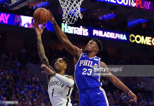 Angelo Russell of the Brooklyn Nets has his shot blocked by Jimmy Butler of the Philadelphia 76ers in the first half during Game One of the first...