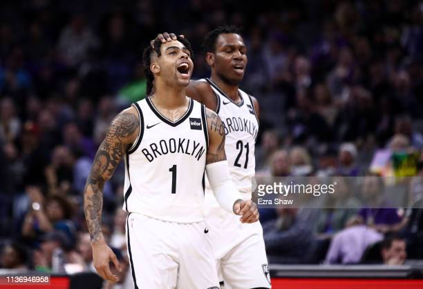 Angelo Russell of the Brooklyn Nets is congratulated by Treveon Graham after Russell made a shot during their game against the Sacramento Kings at...