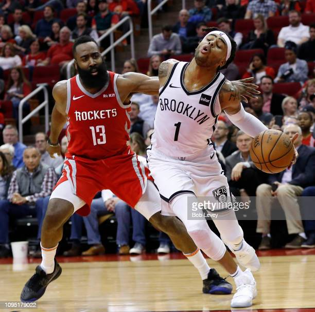 Angelo Russell of the Brooklyn Nets is fouled by James Harden of the Houston Rockets as he is pushed driving to the basket during the second quarter...