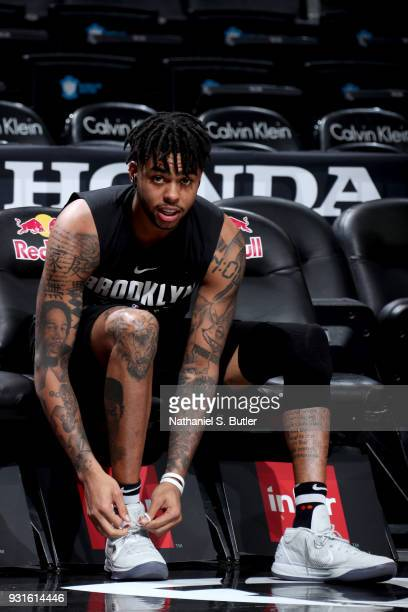 Angelo Russell of the Brooklyn Nets laces up before the game against the Toronto Raptors on March 13 2018 at Barclays Center in Brooklyn New York...