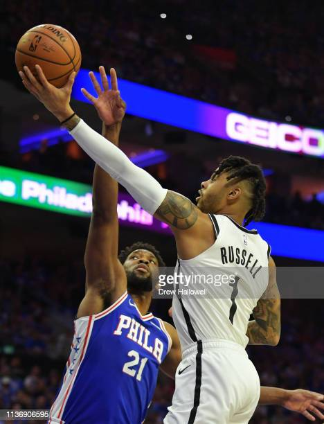 Angelo Russell of the Brooklyn Nets lays up a shot past Joel Embiid of the Philadelphia 76ers in the first half during Game One of the first round of...