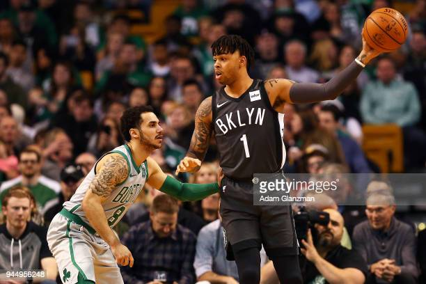 Angelo Russell of the Brooklyn Nets looks to pass the ball while guarded by Shane Larkin of the Boston Celtics during a game at TD Garden on April 11...
