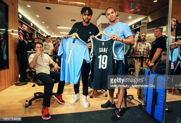 Angelo Russell of the Brooklyn Nets meets Manchester City's Leroy Sane at the NBA Store on July 23 2018 in New York City