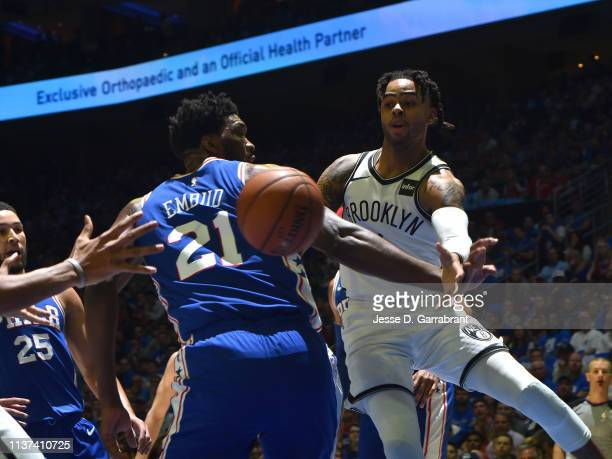 Angelo Russell of the Brooklyn Nets passes the ball against Joel Embiid of the Philadelphia 76ers during Game One of Round One of the 2019 NBA...
