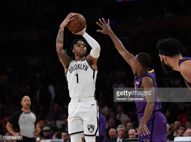 Angelo Russell of the Brooklyn Nets scores a three point basket against Rajon Rondo of the Los Angeles Lakers during the second half of their...