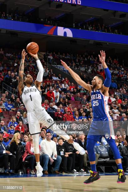Angelo Russell of the Brooklyn Nets shoots the ball against Ben Simmons of the Philadelphia 76ers on March 28 2019 at the Wells Fargo Center in...