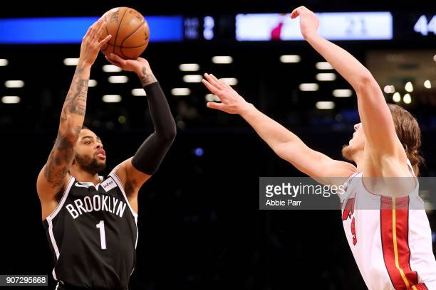 Angelo Russell of the Brooklyn Nets takes a shot against Kelly Olynyk of the Miami Heat after in the second quarter in his return after suffering a...