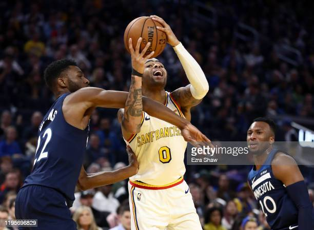 Angelo Russell of the Golden State Warriors is fouled by Andrew Wiggins of the Minnesota Timberwolves at Chase Center on December 23 2019 in San...