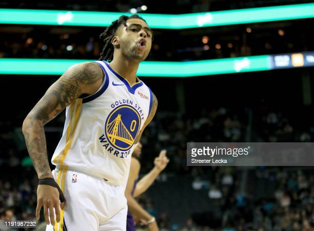 Angelo Russell of the Golden State Warriors reacts after making a basket against the Charlotte Hornets during their game at Spectrum Center on...
