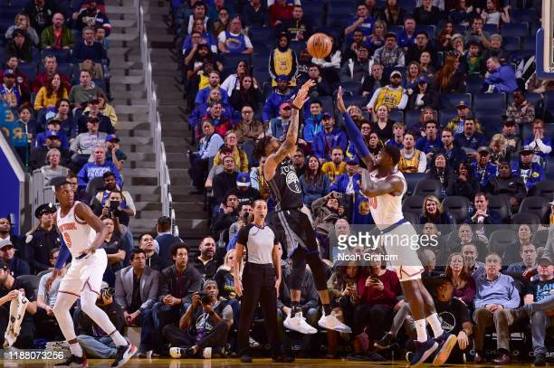 Angelo Russell of the Golden State Warriors shoots a 3-point to send the game into overtime during the game against the New York Knicks on December...