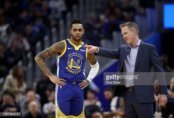 Angelo Russell of the Golden State Warriors speaks to head coach Steve Kerr of the Golden State Warriors during their game against the Utah Jazz at...