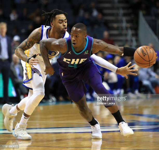 Angelo Russell of the Golden State Warriors tries to stop Terry Rozier of the Charlotte Hornets during their game at Spectrum Center on December 04,...
