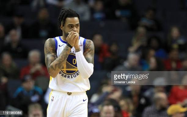 Angelo Russell of the Golden State Warriors watches on against the Charlotte Hornets during their game at Spectrum Center on December 04, 2019 in...