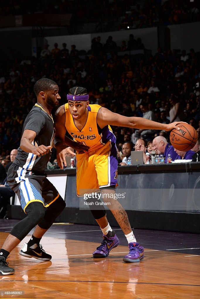 D'Angelo Russell #1 of the Los Angeles Lakers dribbles the ball against the Golden State Warriors during a preseason game on October 17, 2015 at Valley View Casino Center in San Diego, California.