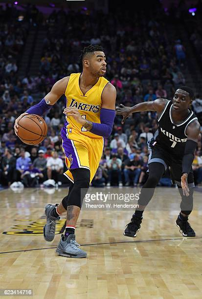 Angelo Russell of the Los Angeles Lakers dribbles the ball past Darren Collison of the Sacramento Kings during an NBA basketball game at Golden 1...