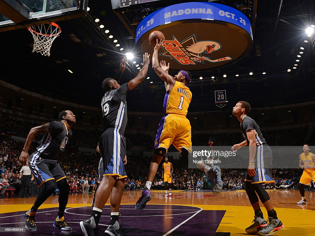 D'Angelo Russell #1 of the Los Angeles Lakers drives to the basket and shoots the ball against the Golden State Warriors during a preseason game on October 17, 2015 at Valley View Casino Center in San Diego, California.