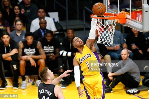 D'Angelo Russell of the Los Angeles Lakers dunks the ball against the Brooklyn Nets on November 15 2016 at the Staples Center in Los Angeles...