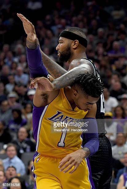Angelo Russell of the Los Angeles Lakers gets tangled up with DeMarcus Cousins of the Sacramento Kings during an NBA basketball game at Golden 1...